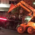 VIDEO: Protesters Steal Skid Steer and New Cars Off Showroom Floor During Oakland Riots