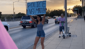 Conservative Reporter Attacked by BLM Protester for Holding 'Police Lives Matter' Sign