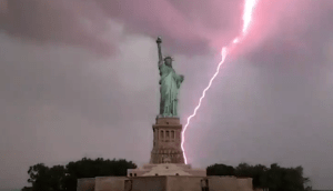 VIDEO: Moment Lightning Strikes Behind The Statue of Liberty