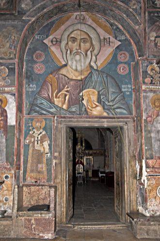 Улаз у цркву. Приказ Христа горе и Светог Саве са леве стране.