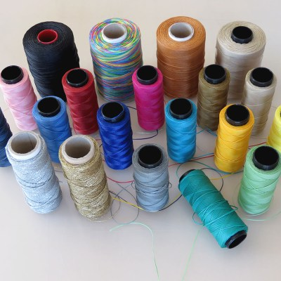 Choosing from a wide choice of coloured or traditionaly used threads