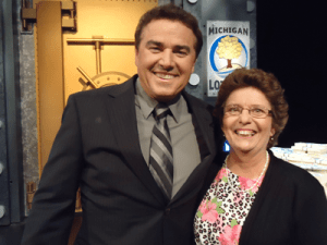 """Play It Again"" $1,000,000 Giveaway! winner Judith M. Powell of Essexville with former ""Brady Bunch"" star Christopher Knight."