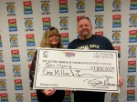 John Morris pictured with his wife of Waterford claiming $1 million from  the Mega Millions, December 13, 2013 drawing. (Photo courtesy of the Michigan Lottery.)