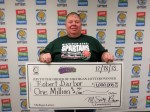 Robert Darbor of Mason claims $1 million prize on Dec.18 at Lottery Headquarters. (Photo courtesy of Michigan Lottery)