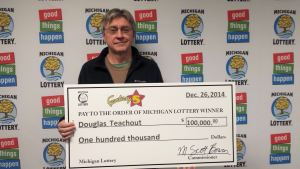 Allen Park resident, Doug Teachout, poses for a photo after collecting his $100,000 Fantasy 5 jackpot at Michigan Lottery headquarters.
