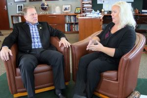 Lisa Scholten (right) talks with Michigan State University basketball coach Tom Izzo prior to accepting her Excellence in Education Award from the Michigan Lottery.