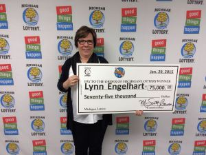 Lynn Engelhart was all smiles when she visited Lottery headquarters to collect her $75,000 Cashword prize.