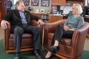 Michelle U'Ren (right) talks with Michigan State University basketball coach Tom Izzo prior to accepting her Excellence in Education Award from the Michigan Lottery.