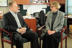 Susan Mokrzycki talks with Michigan State University basketball coach, Tom Izzo, prior to accepting her Excellence in Education Award from the Michigan Lottery.
