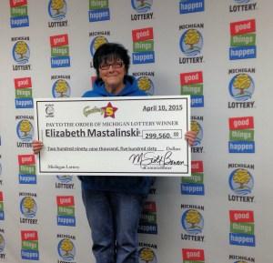 Elizabeth Mastalinski was all smiles while collecting her big Fantasy 5 jackpot Friday.