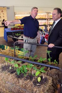 Michael Craig gives Michigan State University basketball coach, Tom Izzo, a tour of his horticulture class room at the Charles Drew Transition Center in Detroit.
