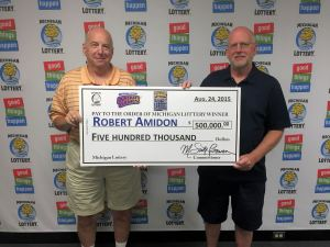 Bob Amidon (left) and his brother, Ron, pose for a photo after Bob collected his $500,000 prize.
