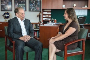 Amanda Thorpe talks with Michigan State University basketball coach, Tom Izzo, after accepting her Excellence in Education award.