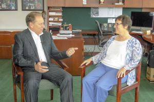 Lynne Cobb talks with Michigan State University basketball coach, Tom Izzo, after accepting her Excellence in Education award.