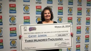 Cathy Lemon smiles after claiming a $300,000 prize form the Michigan Lottery.