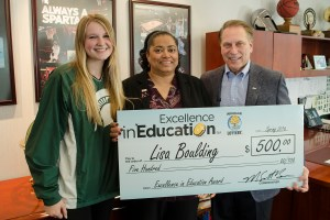 Lisa Boulding (center) poses for a photo with former student and FCCLA, Audrey Koutney, after accepting her Excellence in Education award from Michigan State University basketball coach Tom Izzo.