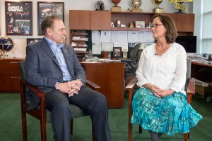 Nancy Cool talks with Michigan State University basketball coach, Tom Izzo, after accepting her Excellence in Education award.