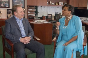 Yamaka Bracey talks with Michigan State University basketball coach, Tom Izzo, after accepting her Excellence in Education award.
