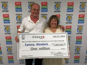 Tammy Weadock and here husband, Terry, smile after claiming a $1 million Powerball prize.