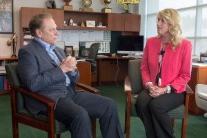 Shawn Mahfet talks with Michigan State University basketball coach, Tom Izzo, after accepting her Excellence in Education award.