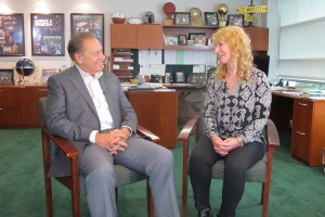 Dawn Wedemeyer talks with Michigan State University basketball coach, Tom Izzo, after accepting her Excellence in Education award.