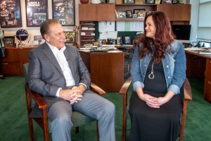 Andrea Donovan talks with Michigan State University basketball coach, Tom Izzo, after accepting her Excellence in Education award.