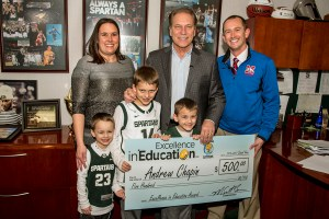 Andrew Chapin poses for a photo with (left to right) his wife, Camy Chapin, and sons, Camden, Carson, and Caleb, after accepting his Excellence in Education award from Michigan State University basketball coach Tom Izzo.