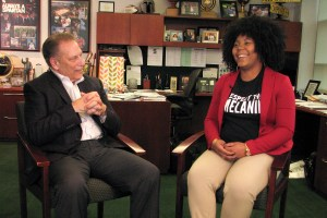Sirrita Darby talks with Michigan State University basketball coach, Tom Izzo, after accepting her Excellence in Education award.