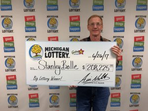 Stanley Bolle smiles after collect his $208,225 Fantasy 5 jackpot.