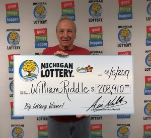 William Riddle smiles after collecting his $208,910 Fantasy 5 jackpot.