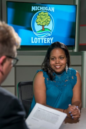 Dianna Jones is interviewed after being presented with an Excellence in Education award from the Michigan Lottery.