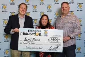 Kerri Moccio poses for a photo with her husband, Craig, and Michigan Lottery Commissioner, Aric Nesbitt, after accepting her Excellence in Education Award.