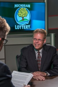 Mark Honeyman is interviewed after being presented with an Excellence in Education award from the Michigan Lottery.