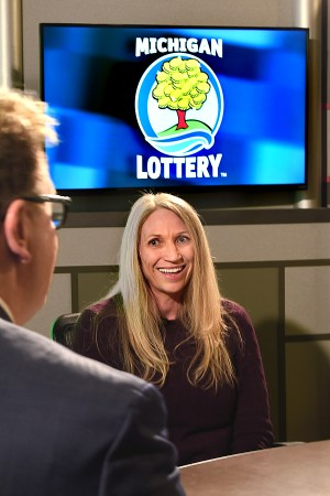 Holly Hereau is interviewed after being presented with an Excellence in Education award from the Michigan Lottery.