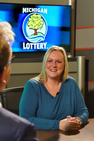 Wendy Thomas is interviewed after being presented with an Excellence in Education award from the Michigan Lottery.