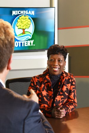 Dr. Letha Hopkins-Powell is interviewed after being presented with an Excellence in Education award from the Michigan Lottery.