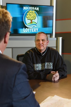 Dave Richardson is interviewed after being presented with an Excellence in Education award from the Michigan Lottery.