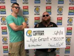 Kyle Grant (right) poses for a photo with his friend, Joe Webb, after collecting his $75,000 prize.