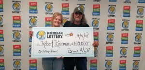 Robert Bierman and his wife, Debbie, smile after collecting a $100,000 Fantasy 5 jackpot.