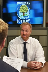 Brian Bearss is interviewed after being presented with an Excellence in Education award from the Michigan Lottery.