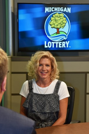 Christine Burkhardt-Messner is interviewed after being presented with an Excellence in Education award from the Michigan Lottery.