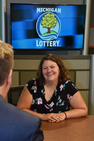 Janae Russell is interviewed after being presented with an Excellence in Education award from the Michigan Lottery.