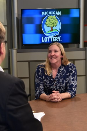 Natalie Donovan is interviewed after being presented with an Excellence in Education award from the Michigan Lottery.