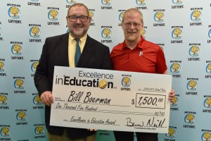 Bill Boerman (right) poses for a photo with Michigan Lottery public relations director, Jeff Holyfield, after accepting his Excellence in Education Award.