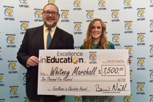 Whitney Marshall (right) poses for a photo with Michigan Lottery public relations director, Jeff Holyfield, after accepting her Excellence in Education Award.