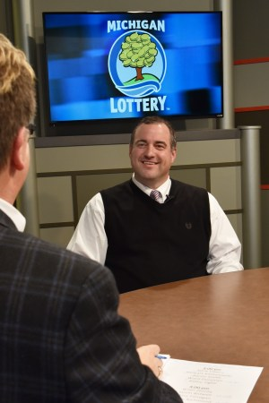 Brian Zezula is interviewed after being presented with an Excellence in Education award from the Michigan Lottery.