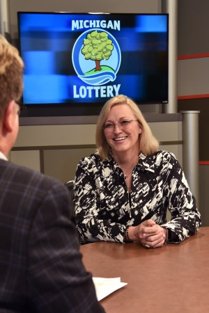 Terie Elbers is interviewed after being presented with an Excellence in Education award from the Michigan Lottery.