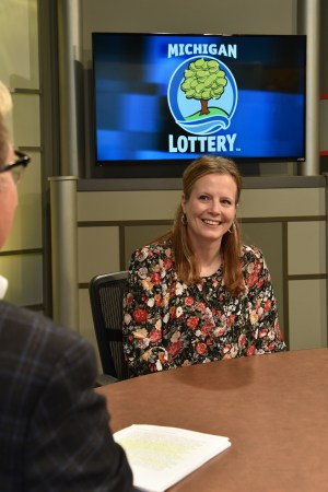 Mary Finnigan is interviewed after being presented with an Excellence in Education award from the Michigan Lottery.
