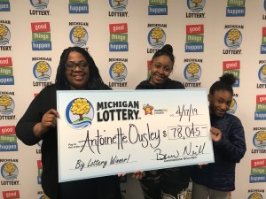 Antoinette Ousley, and her children, smile after collecting Ousley's $78,045 Fantasy 5 jackpot.