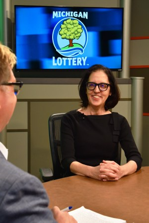 Margy Barile is interviewed after being presented with an Excellence in Education award from the Michigan Lottery.